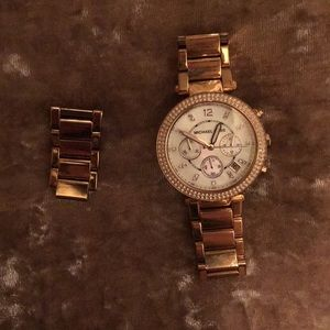 Michael Kors rose-gold watch with pearl interior